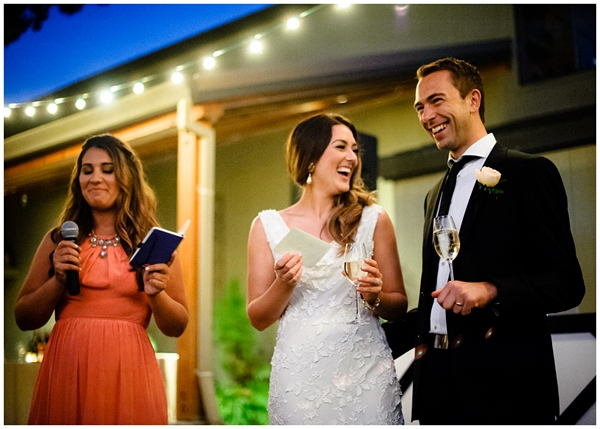 laughing bride and groom during toasts