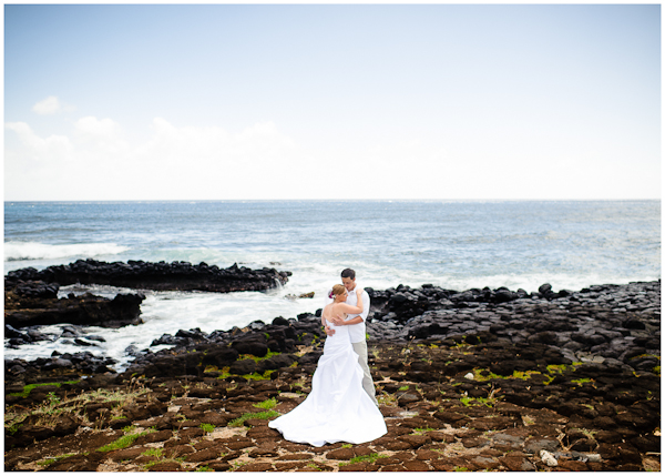 bride and groom on rocky south shore of kauai in poipu