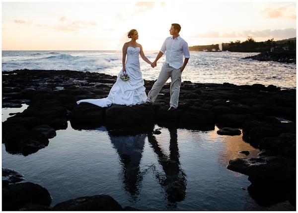 reflection wedding portraits in kauai sunset high surf