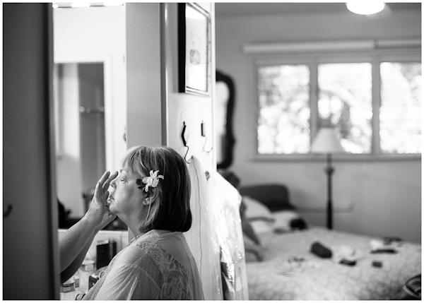 mother of bride getting makeup done in doorway