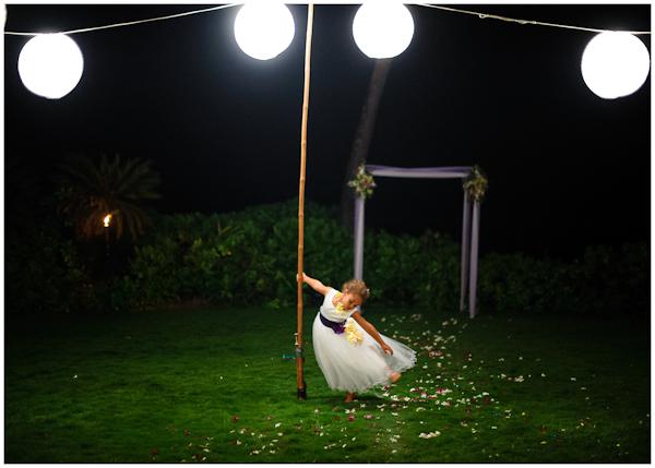 little flower girl twirling at wedding reception