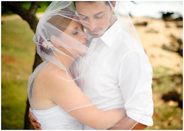 veil covering bride groom on hawaii