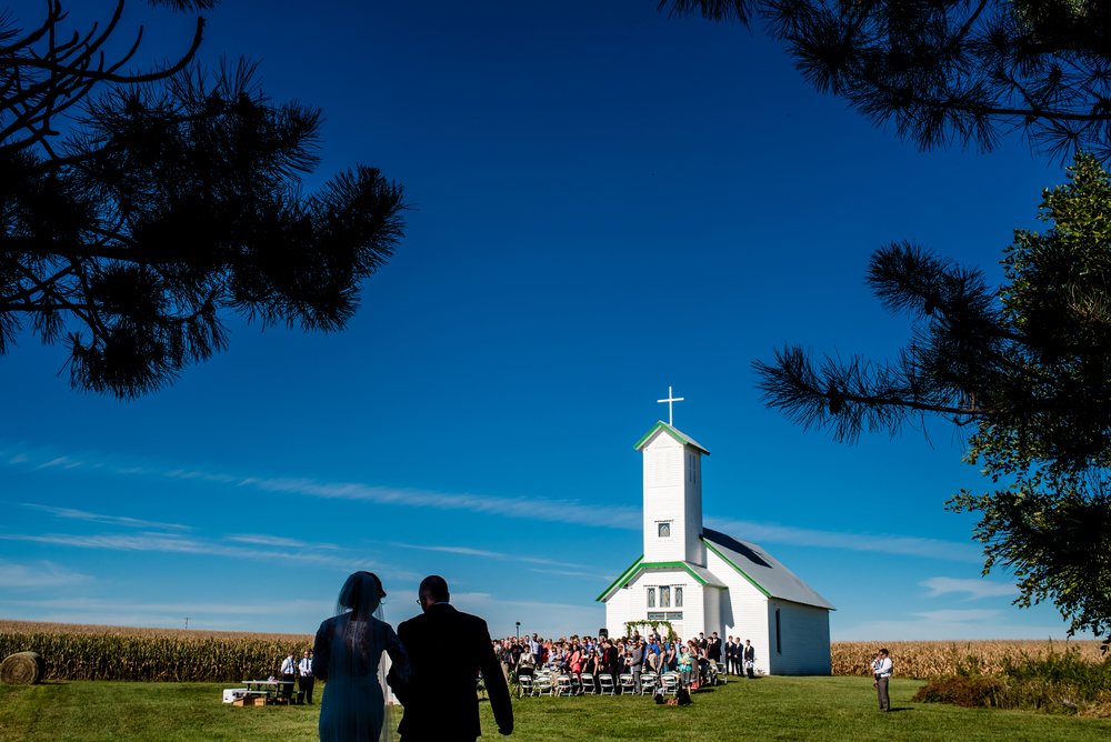Megan's dad walking her down the aisle of their remote chapel in the middle of the country...Carson, Iowa...a mere 40 minutes away.