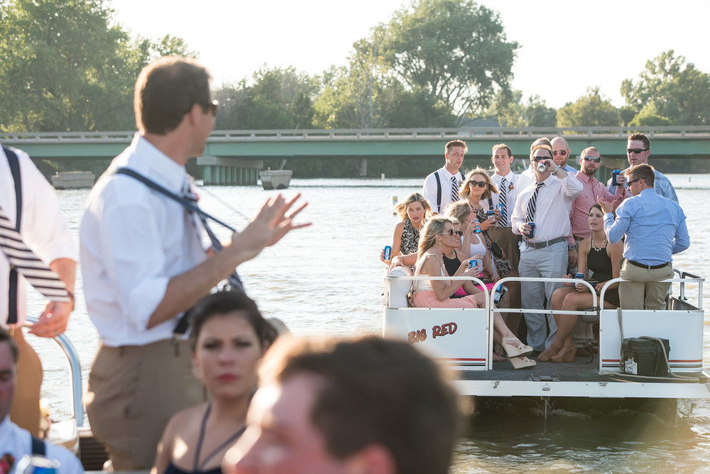 PONTOON RIDE AT NEBRASKA WEDDING.jpg