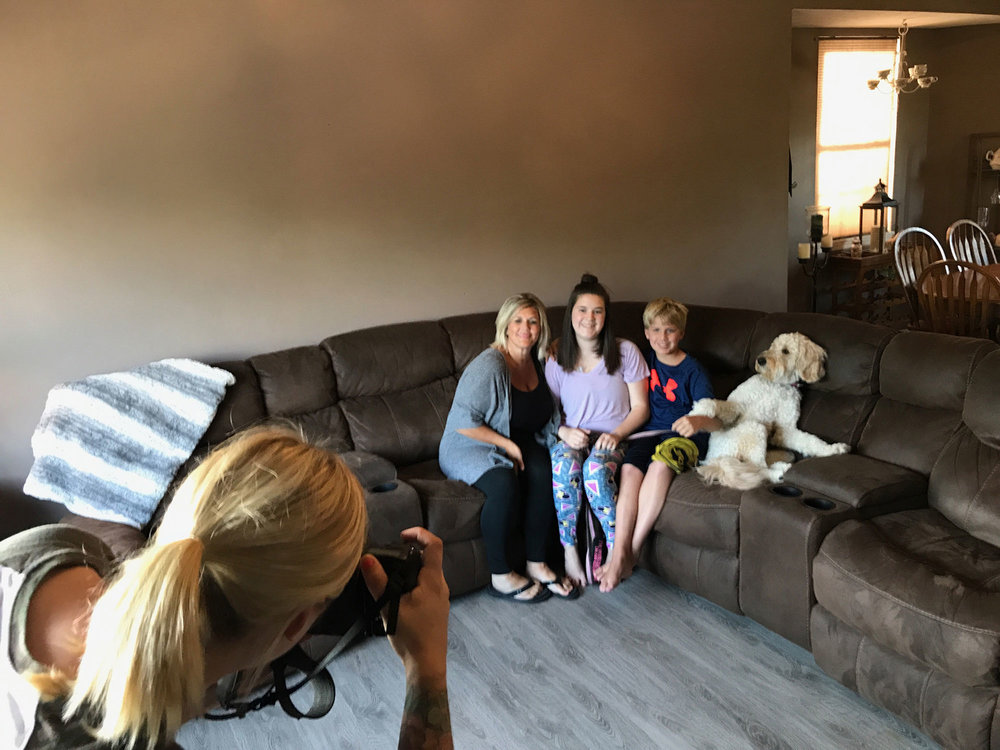 MCKENZIE PHOTOGRAPHING FAMILY FOR CHIVE CHARITIES.jpg