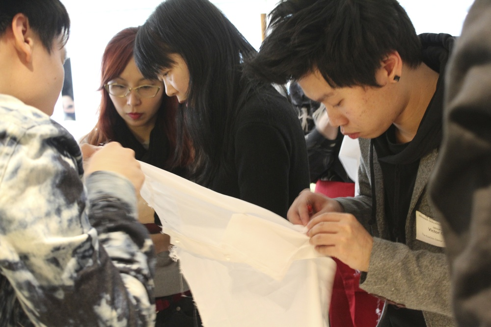 A new technique – inspired by the RSA's Great Recovery – is the 'break down', where the workshop participants use quick unpick tools to take apart a shirt, and then each remake a part, before bringing the pieces back together to create single upcycled item.