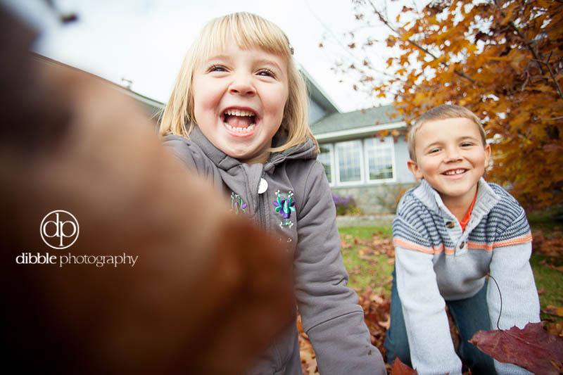 kids in a leaf pile