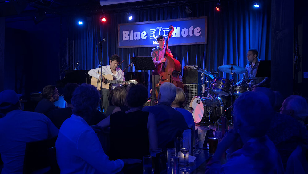 On 08/08/2018, as a release concert for the new album THERE AND HERE, the Carlos Henrique Pereira Trio played for a sold out Blue Note in Napa, CA. Carlos played the acoustic guitar and piano with Tyler Harlow on acoustic and electric bass and Lorca Hart on drums.