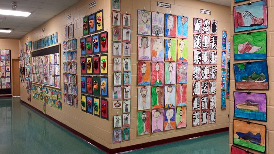 Colorful student art brightens the walls throughout the evening of the Silent Auction and Art Show.