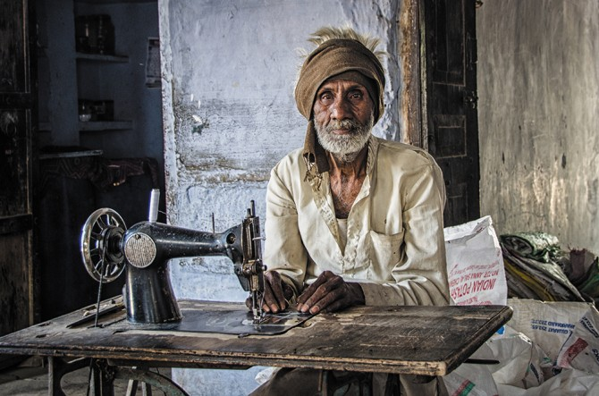 A man sewing in Todi Garh