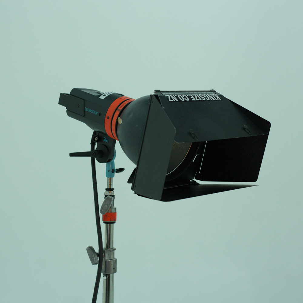 Broncolor P70 nine-inch reflector with barn doors