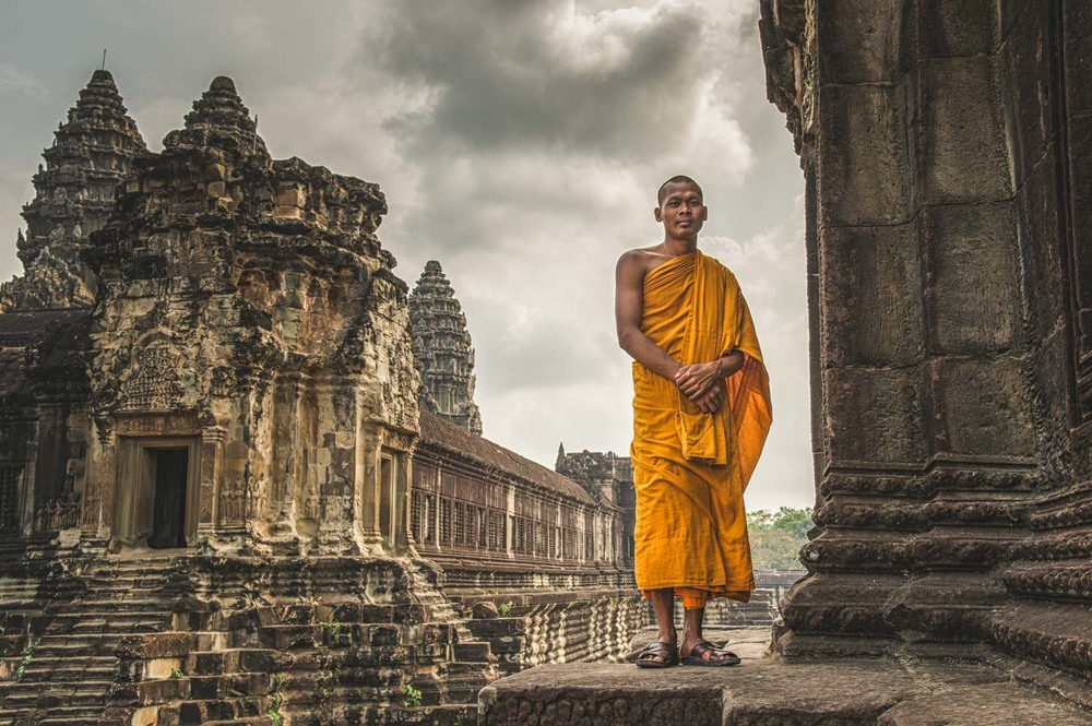 Buddhist Monk outside part of the enormous complex that is Angkor Wat;Nikon D4S, 32mm, f/8, 1/160s, ISO 100