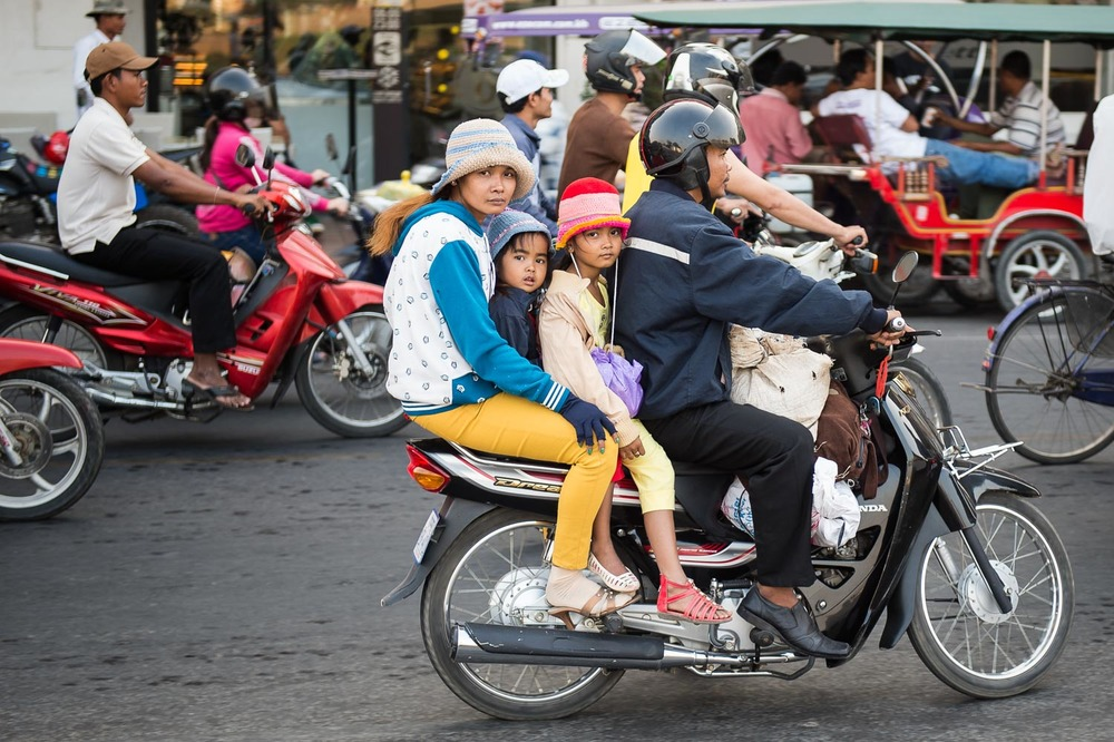 Family on scooter, Phnom Penh; Nikon D4S, 52mm, f/2.8, 1/100s, ISO 110