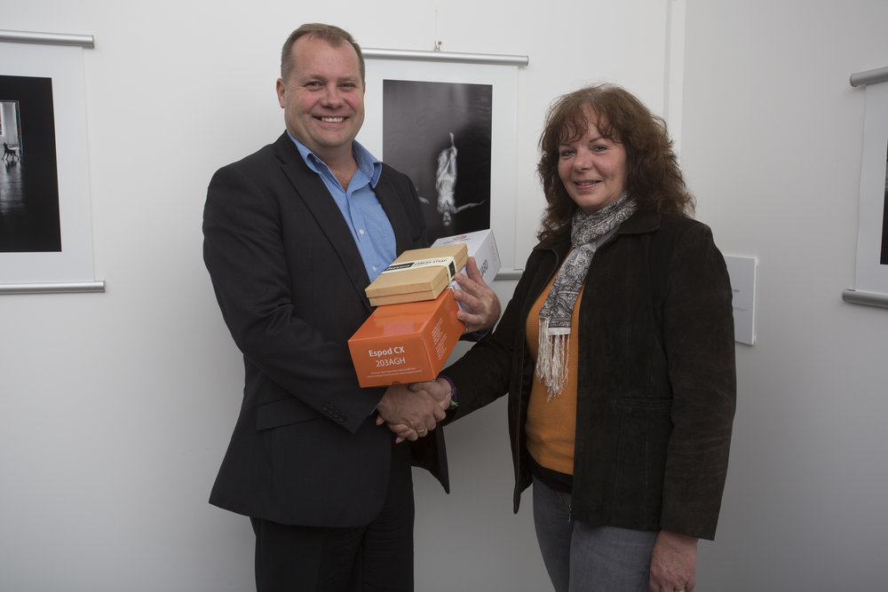 Gerard Emery from CRK hands over the Vanguard prize pack to third-placing Monochrome photographer, Karen Moffat-Mcleod