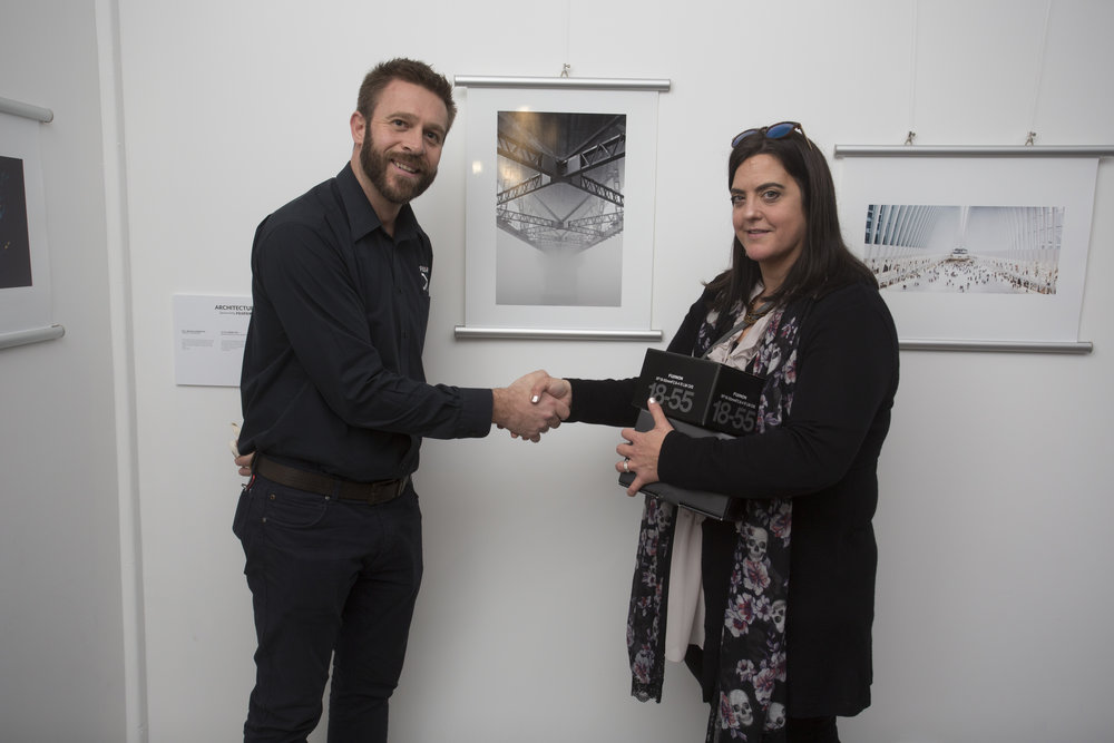 Ira Swales from Fujifilm congratulates Michelle Denniston, who achieved first place in Architecture