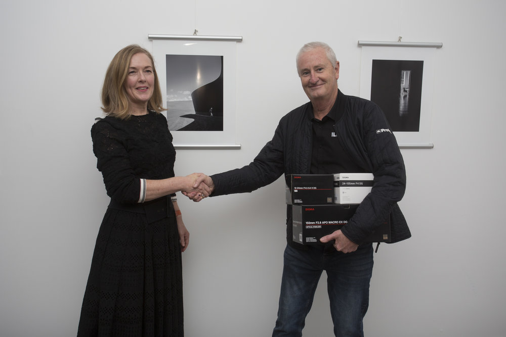 Amateur Photographer of the Year for 2018, Kate Parsonson, with her two winning images, receiving prizes from Mark Ward of Sigma/CRK