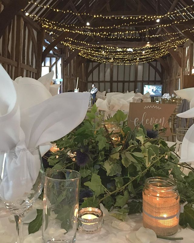Beautiful @greatbarnvenue if your planning a wedding/Event this venue is stunning. . 25th wedding Anniversary. Keeping it simple with mixed greenery wreaths. Ivy, Olive and Thistles. Fairy light ceiling ✨and lots of candles to create a romantic look. . #barnwedding #barnevents #anniversary #beautiful #greatbarn #venuestyling #eventstyling #pretty #romantic #stunning #candles #sparkle #wreaths #greenery #flowers #florist #london #love #friday #party #25years #summerlove