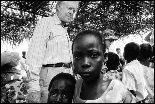 ©Eli Reed                                                                                  Former President Jimmy Carter, Village of Danchira, Ghana, 1989
