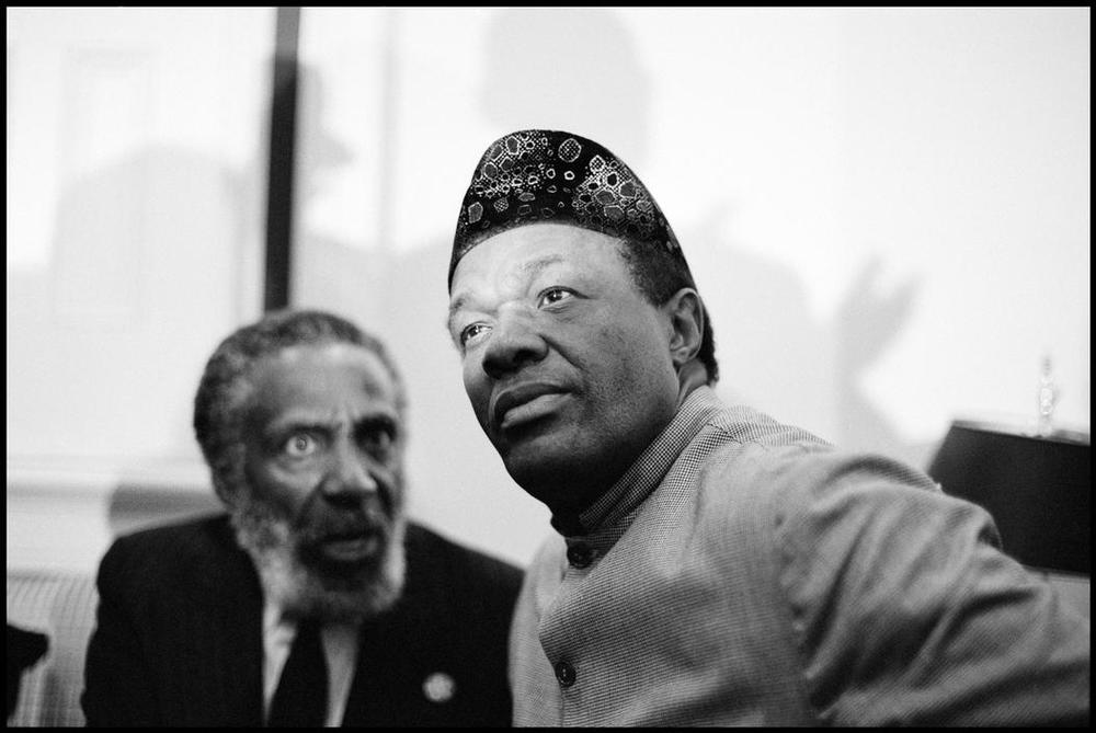Black Activist Dick Gregory Confers with Marion Barry Before a Press Conference, 1993    © Eli Reed