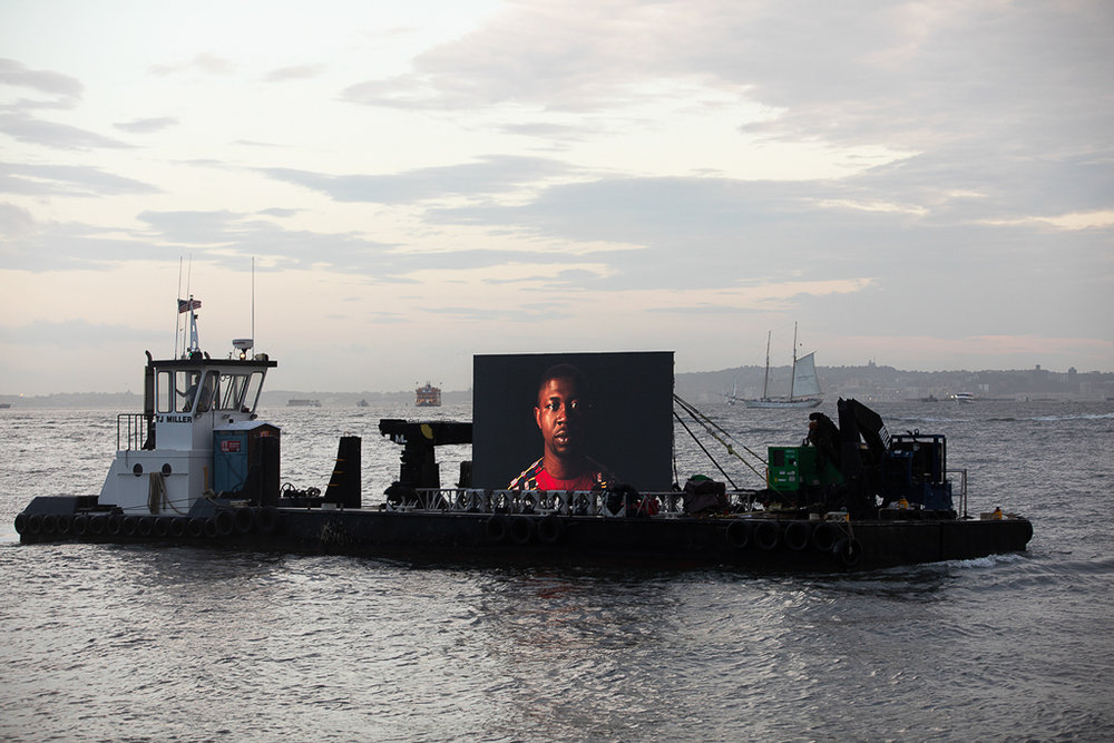 "©  Shimon Attie Night Watch (Edafe), Hudson River, Barge, Tugboat, 20' wide hi-res LED screen, 30""X45""/48""X72"" Lambda Photograph, Shimon Attie, 2018, courtesy of Jack Shainman Gallery, NY"