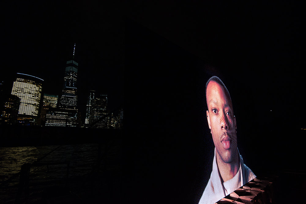 """©  Shimon Attie  Night Watch (Marvin with Tower), Hudson River , Barge, Tugboat, 20' wide hi-res LED screen, 30""""X45""""/48""""X72"""" Lambda Photograph, Shimon Attie, 2018, courtesy of Jack Shainman Gallery, NY"""