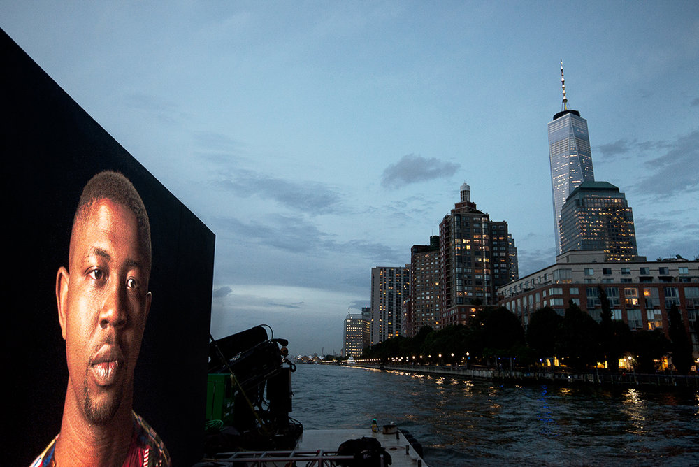 """©  Shimon Attie  Night Watch (Edafe with Tower), Hudson River , Barge, Tugboat, 20' wide hi-res LED screen, 30""""X45""""/48""""X72"""" Lambda Photograph, Shimon Attie, 2018, courtesy of Jack Shainman Gallery, NY"""