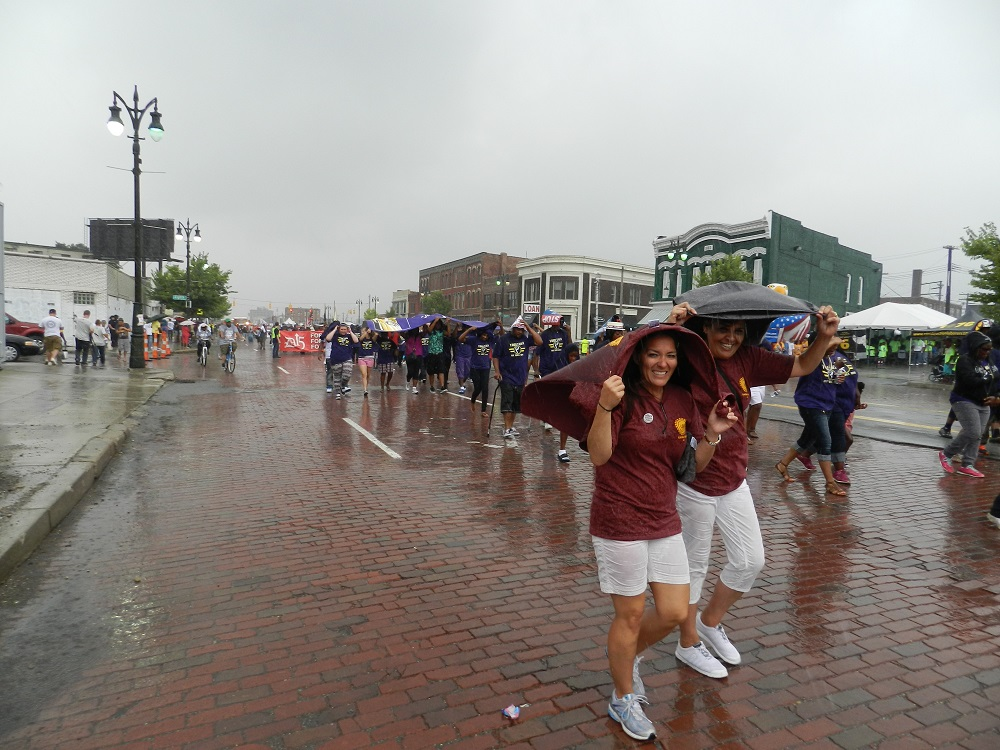 A heavy downpour failed to dampen the spirits of thousands of union members marching in Detroit's annual Labor Day parade Credit Steve Carmody / Michigan Radio