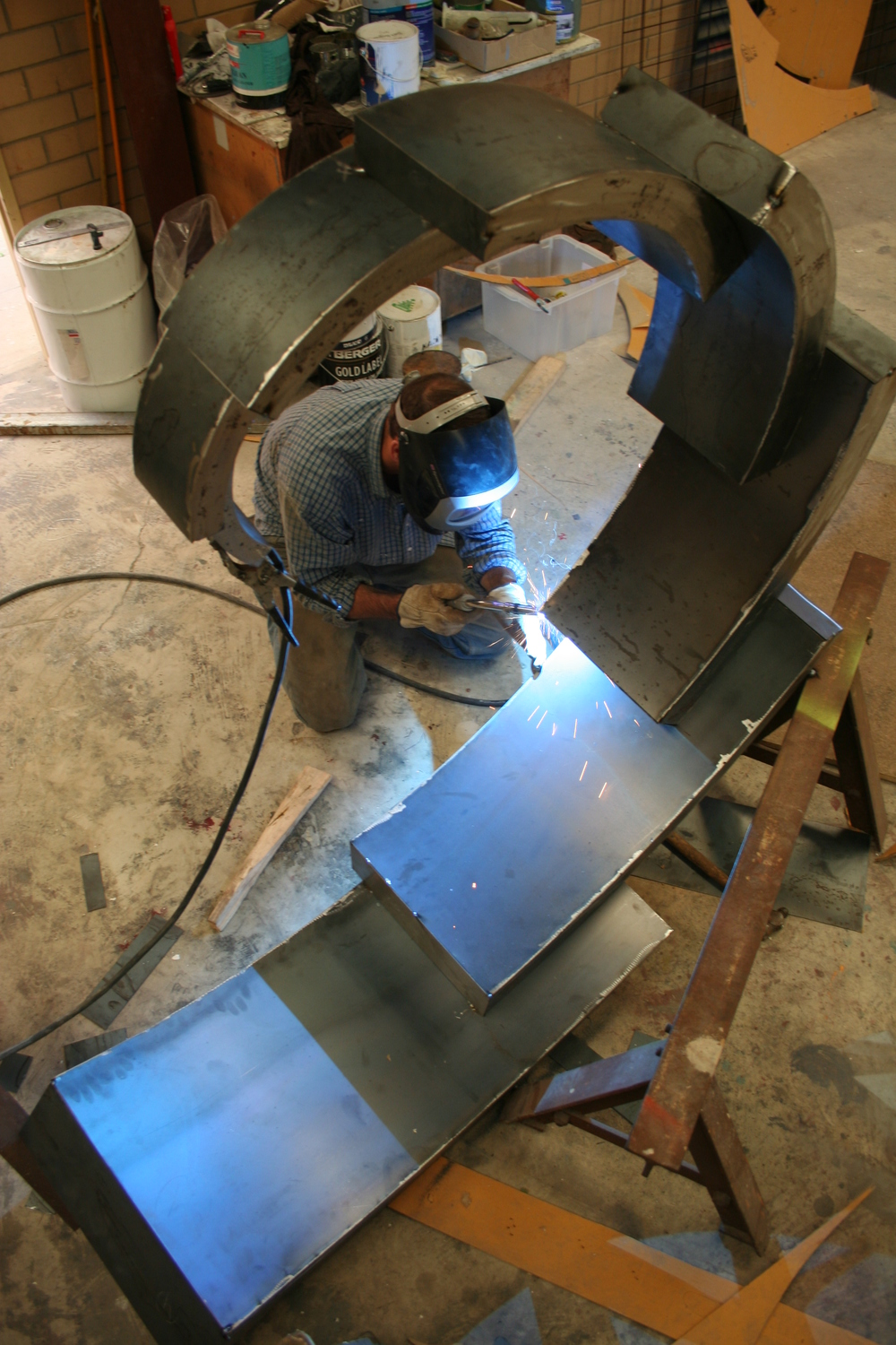 Johannes welding the segmented pieces together  in his workshop