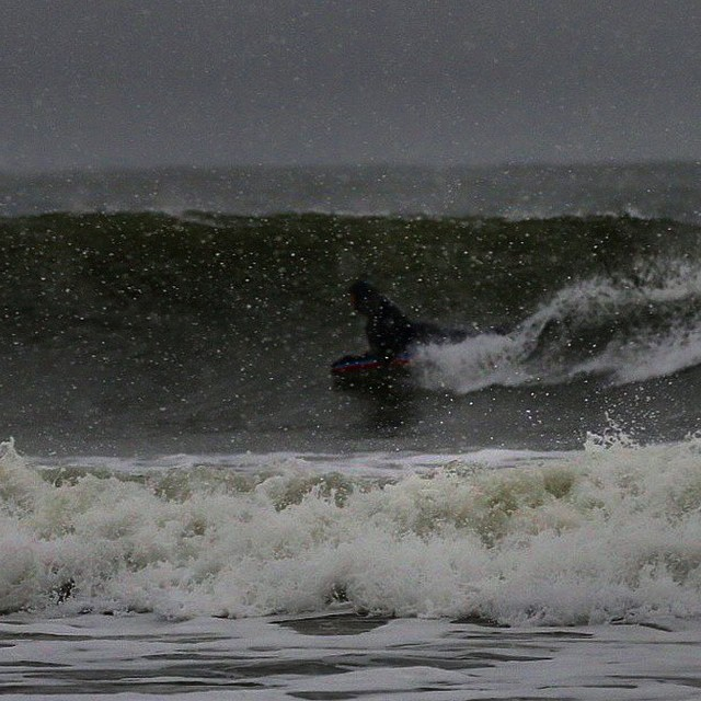 Bogie boarding in wintry mix. Thanks for the capture @look2seaphoto!  #SurfSauna #Winter #Surf