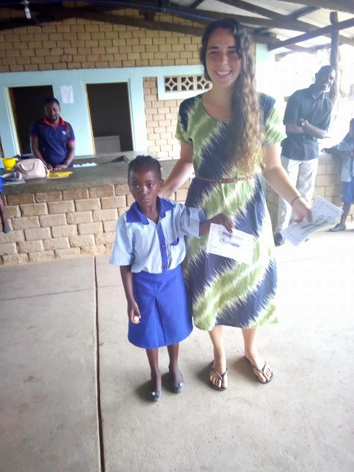 Me giving a grade 1 student the compassion award.