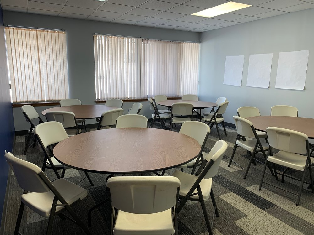 ROOM THREE - Meeting room with 3 rectangular tables and chairs, 1 TV Monitor with Apple TV, Whiteboard.Great for: meetings, classes, study groups,Accommodates up to 30 people.Cost: $20 per hour.
