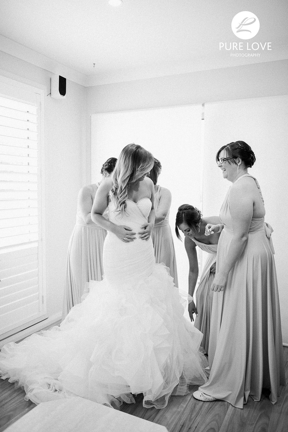 bridesmaids helping to get ready