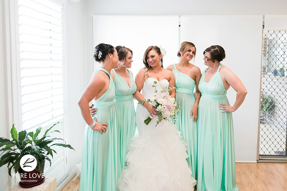 bride with bridesmaids before leaving for the ceremony