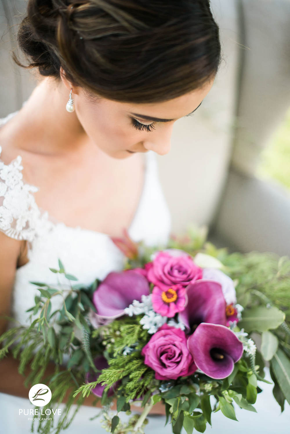 bride with amazing purple flowers