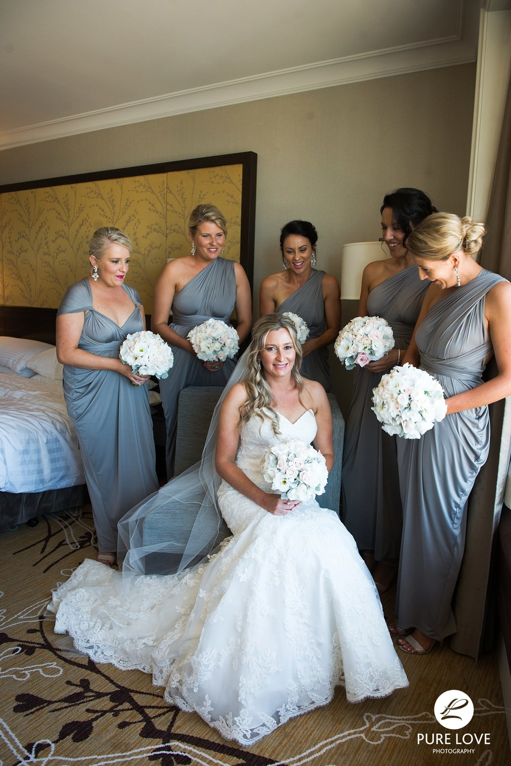 bride with her bridesmaids before leaving for the ceremony