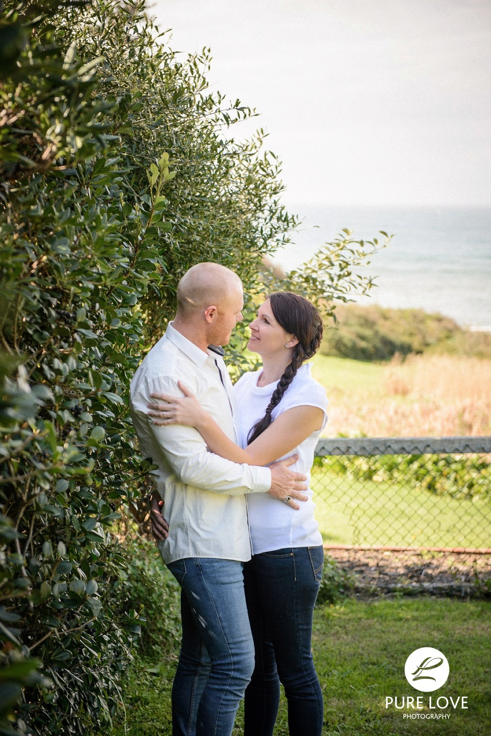 This couple definitely complemented each other by wearing white tops and jeans at their engagement session.