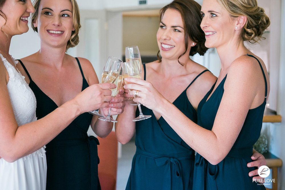 bridesmaids champagne cheering