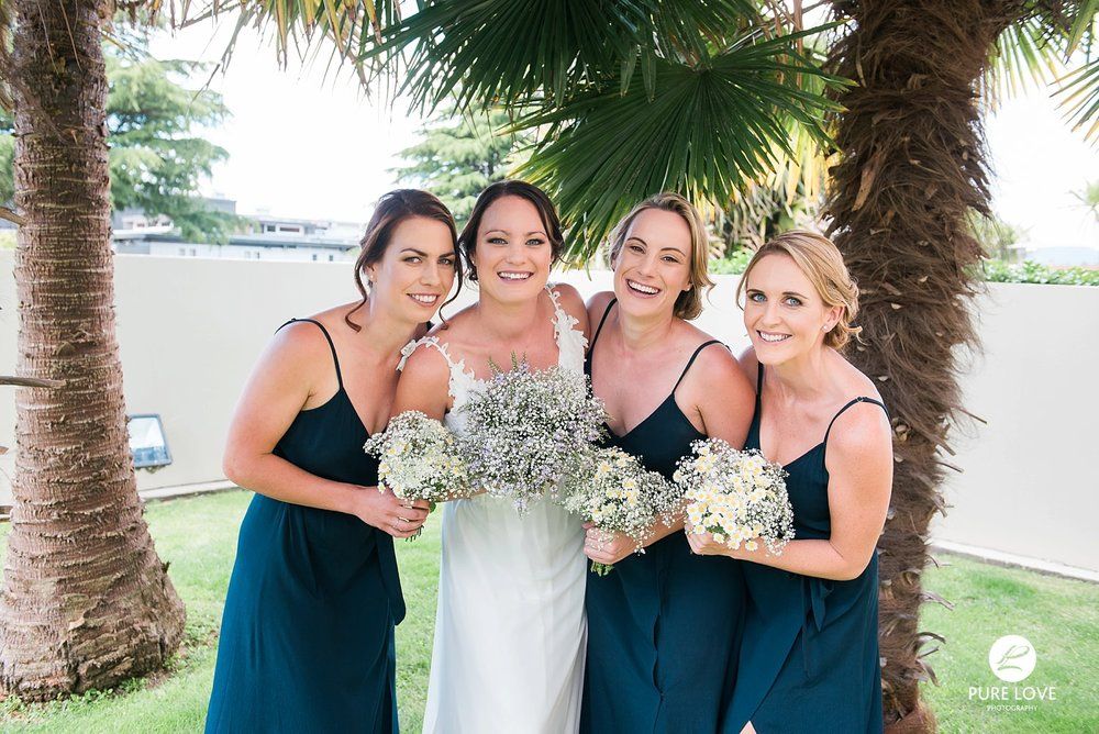 bride and bridesmaids happy