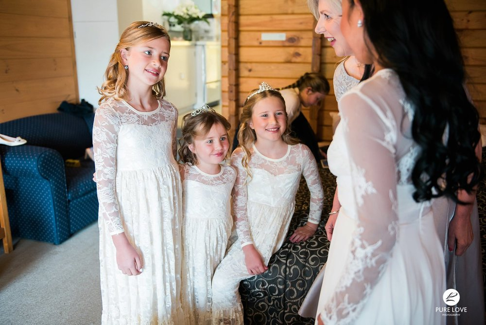 flower girls looking at the bride