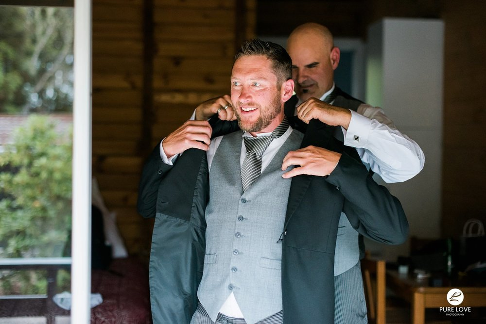 groom is getting dressed