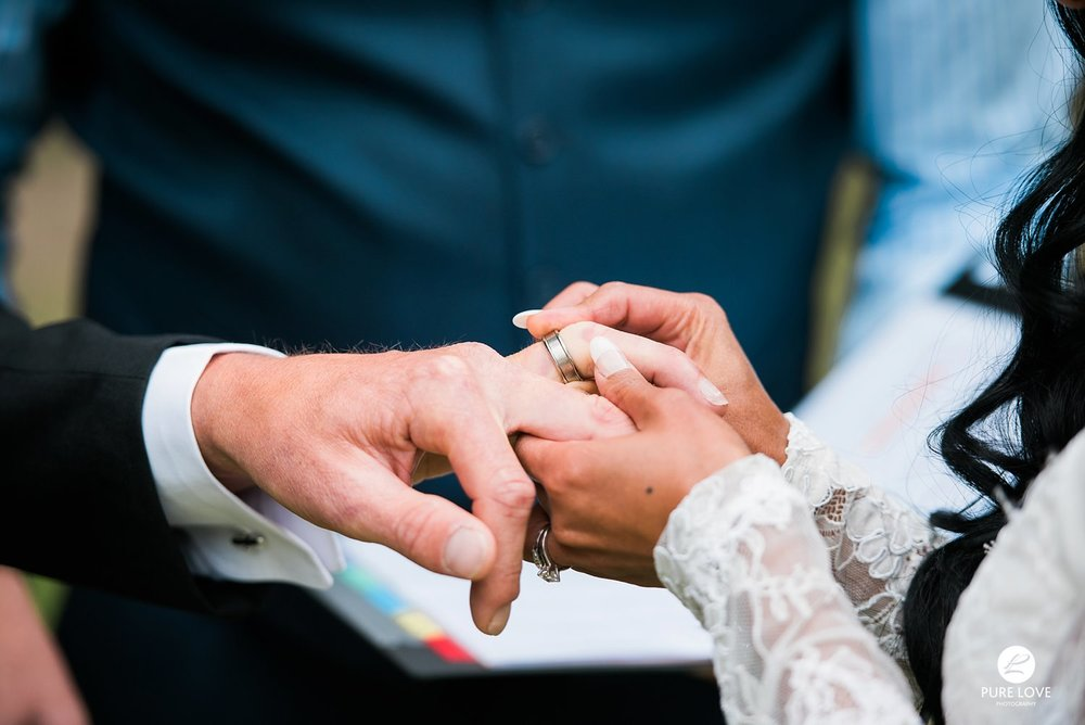 exchanging rings at wedding ceremony