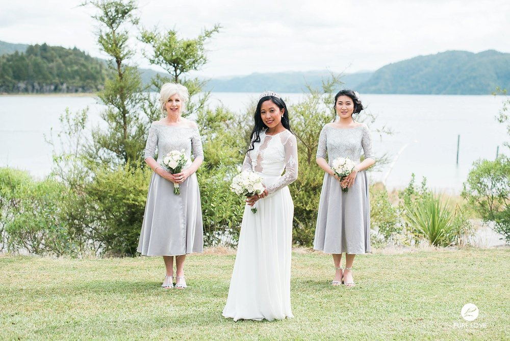bride with bridesmaids light grey dresses