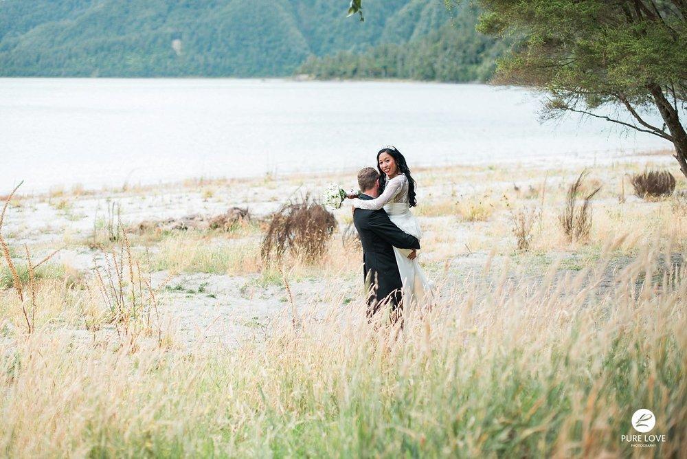 groom is carrying his bride