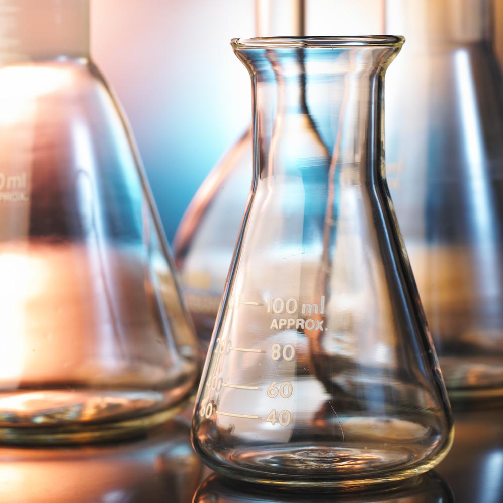 shutterstock_39160669 beaker flask science scientist westech.jpg