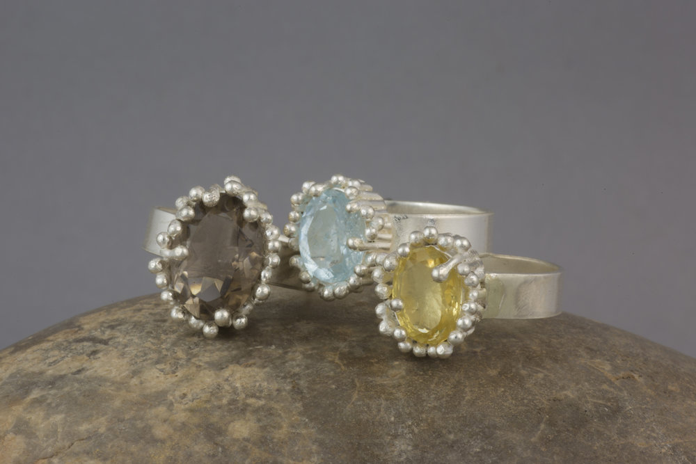 """Reed"" rings featuring smokey quartz, aquamarine and citrine."