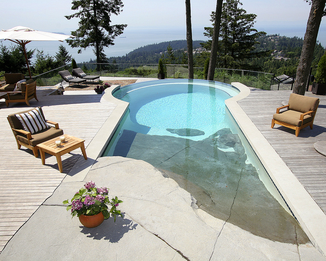 A beautiful pool, with a   simple shape and beach entry by   Alka Pool