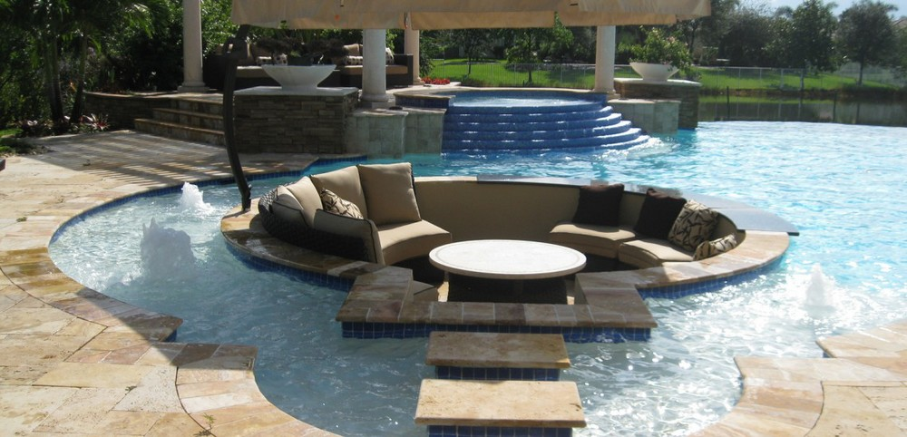 Trends in swimming pool design glinorcal landscape for Luxury pool area