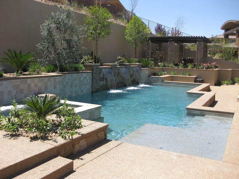 Geometric shapes paired with water features and a low water landscaping results in a beautiful and classic look.  By   Paragon Pools