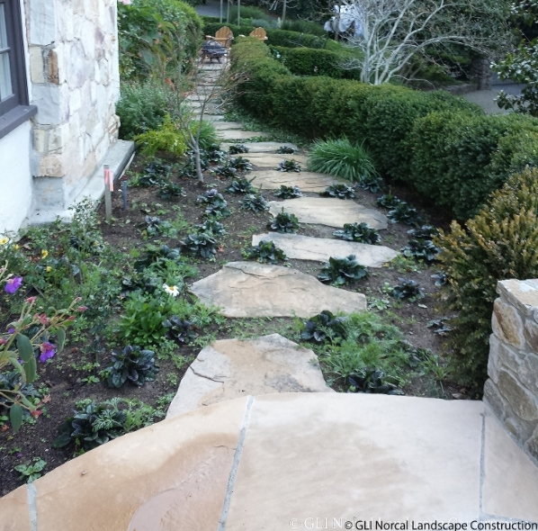 Adding a simple flagstone path and planting completely revamps the side of this home in San Rafael, CA