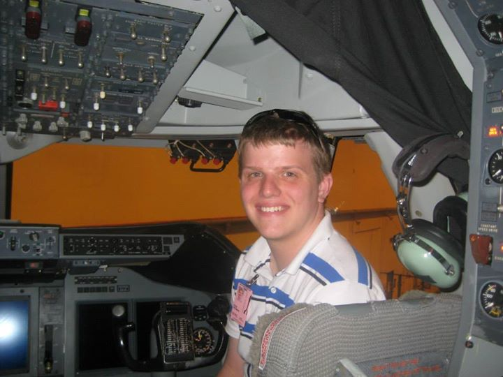 Sean posing in SOFIA, a NASA aircraft